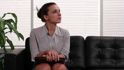 Nervous woman waiting for job interview