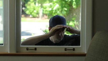 Intruder trying to enter window of home