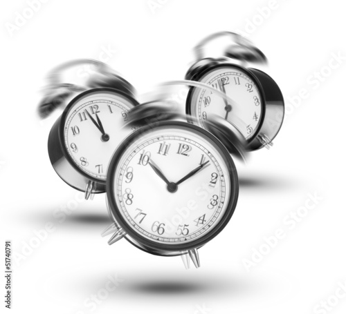Ringing alarm clocks on white background