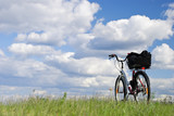 Bike on a grass against clouds