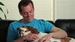 Happy man petting his dog