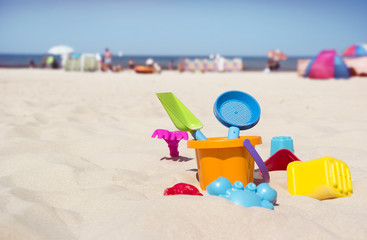 children's toys on beautiful beach sand