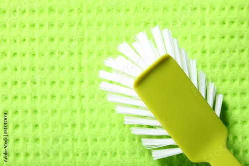 Green sponge background and brush