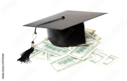 Paid education. Graduate cap on a pile of money