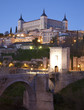 Toledo - Alcazar and Saint Martin bridge in morning dusk