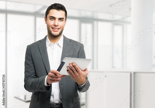 Business man holding his digital tablet