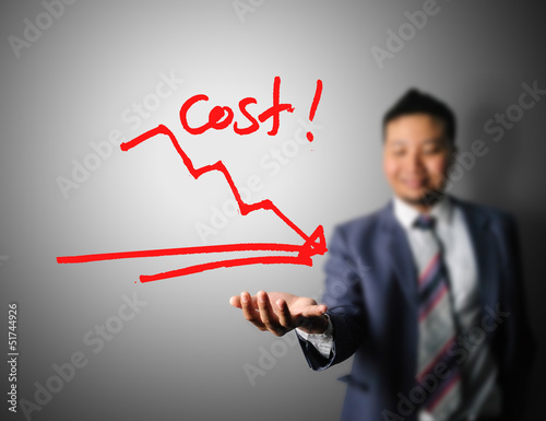 Businessman showing graph of cost reduction