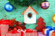 Nesting box  and Christmas decoration on blue background
