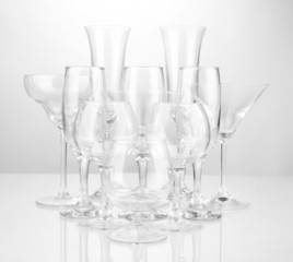 Cocktail and wine glasses, on gray background
