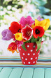 Beautiful tulips in bouquet on table on bright background