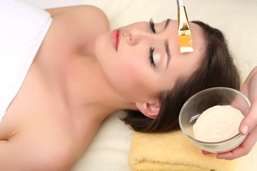 Beautiful young woman in cosmetic salon close up
