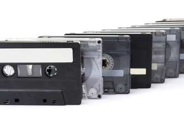 row of audio tapes isolated on white background