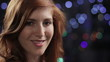 Pretty young red haired woman smiling