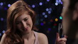 Young woman on a date drinking champagne, dolly shot