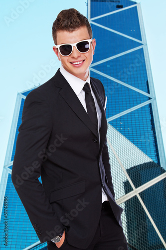 Young and stylish man in front of skyscraper