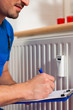 Technician reading the heat meter