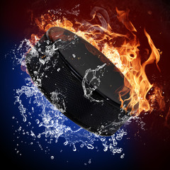 Hockey puck in fire flames and splashing water