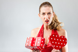 Woman opening the gift and is disappointed