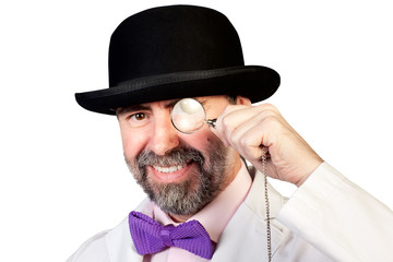 Happy looking man with a monocle in his hand