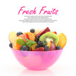 Fresh mixed fruit salad in a pink bowl