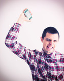 Angry businessman throwing his mobile phone