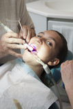 Dentist finishing dental examination with ultraviolet light
