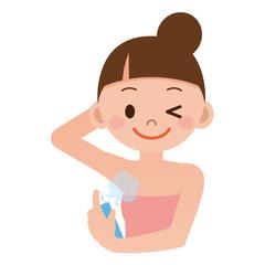 制汗剤スプレーをする女性