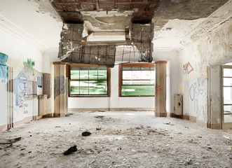 old destroyed building, large room with two windows