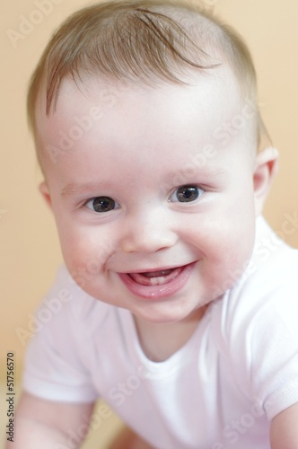 portrait of the happy laughing baby age of 7 months