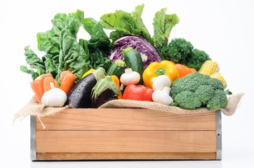 Crate of seasonal fresh vegetables from farmers market