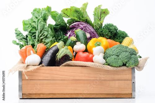 Crate of seasonal fresh vegetables from farmers market