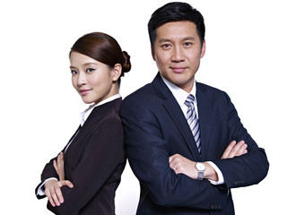 asian business people standing back-to-back, arms crossed