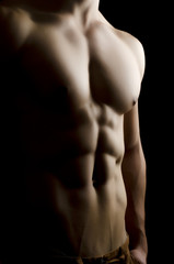 Muscular man body on black background