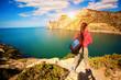 woman tourist enjoys the sea view