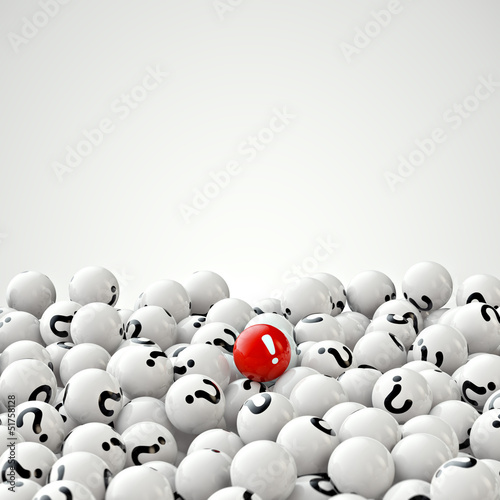 many gray balls with question marks, and one red