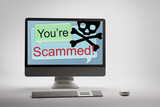 Computer displaying internet fraud and scam warning on screen poster