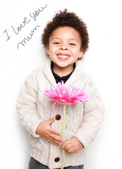 Child with big smile and big pink flower with I love mum message