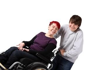 Rollstuhlfahrerin mit Helfer
