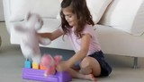 Caucasian girl playing with toys
