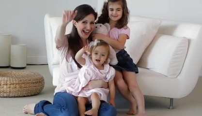 Caucasian mother and girls waving