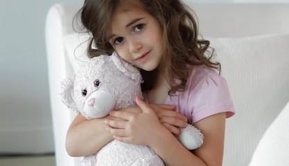 Caucasian girl holding bear