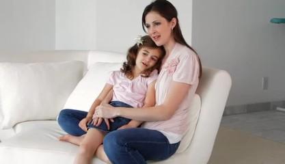 Caucasian mother rocking daughter