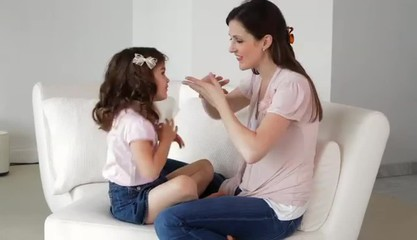 Caucasian mother and daughter playing spider