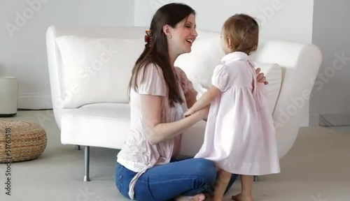 Caucasian mother cleaning nose of daughter