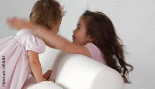 Caucasian girl surprising her little sister