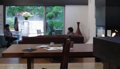 Hispanic man at home working with digital table