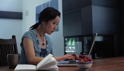 Japanese woman at home typing on laptop