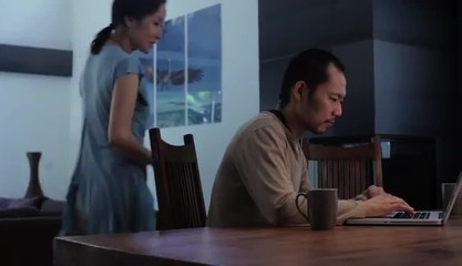 Japanese couple at home enjoying computer