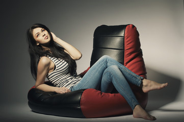 beautiful brunette lying on beanbag