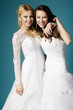 blonde and brunette bride on blue background